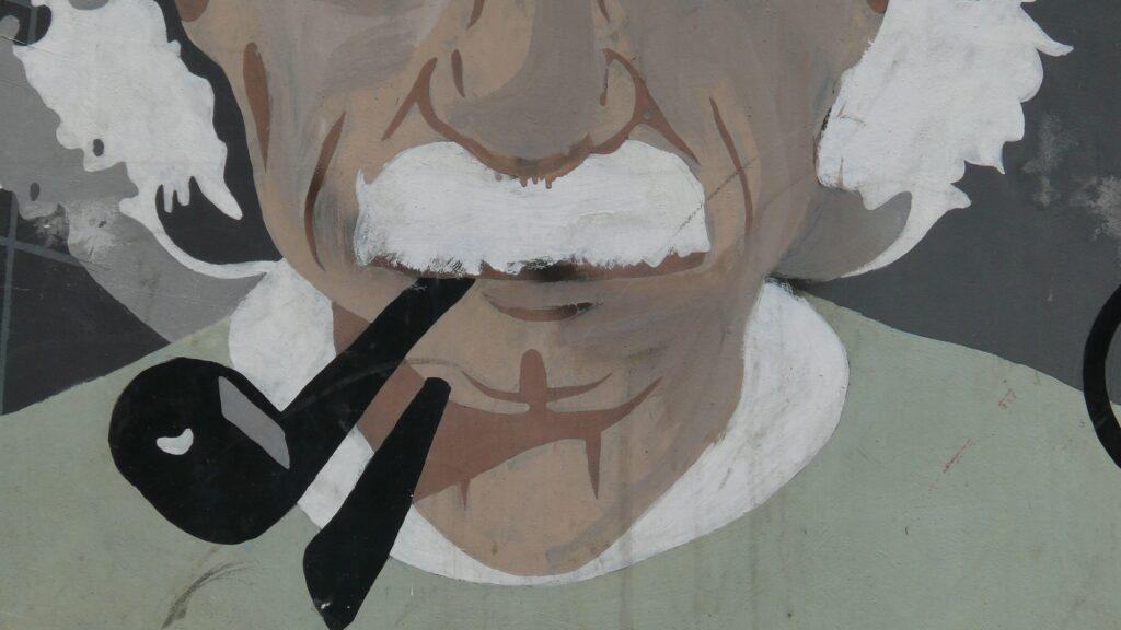 rappresentazione di Einstein con pipa in bocca  stile murales